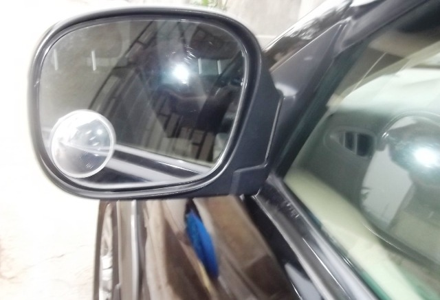 SIDE MIRROR: Essential for viewing rear objects
