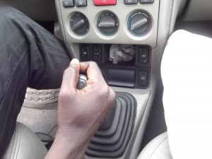 : Press down the clutch pedal before putting the car on first gear or to change from one gear to another