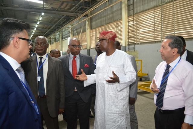 Lukman Mamadu of National Automotive Council explaining a point, during the tour of the facility