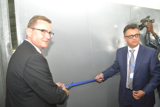 In company of Stallion Group's Vice Chairman, Haresh Vaswani,(Right), Ratz Wolfgang, leader of the Volkswagen Group delegation from Germany, cutting the tape to launch the retooled VW facility in Lagos