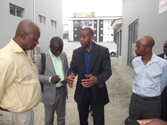Ademola Ade-Ojo (3rd from left), making a point, while conducting journalists round the new JAC facility at Ikaja, Lagos, recently