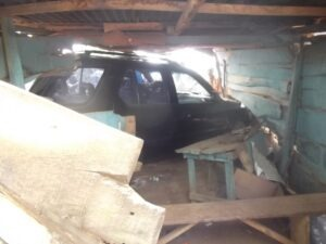 The Isuzu SUV still inside the shop after the accident